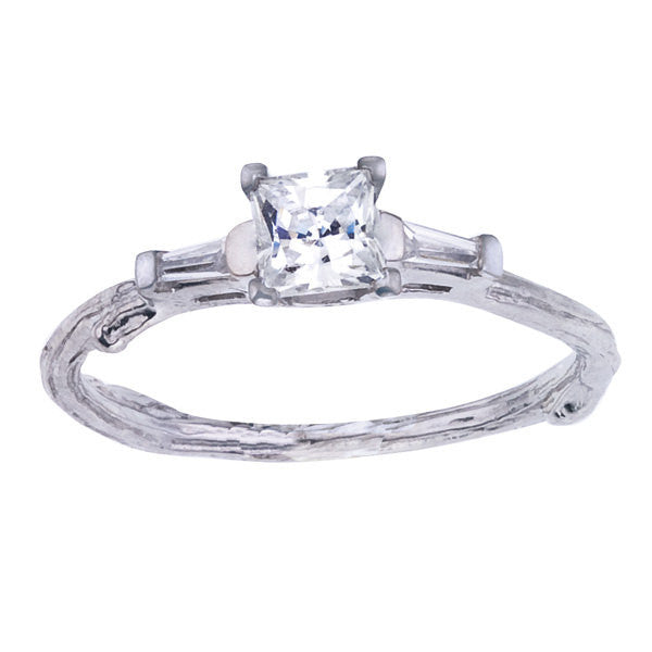 Princess cut diamond twig engagement ring accented with tapered baguettes.  Designed by Barbara Polinsky.