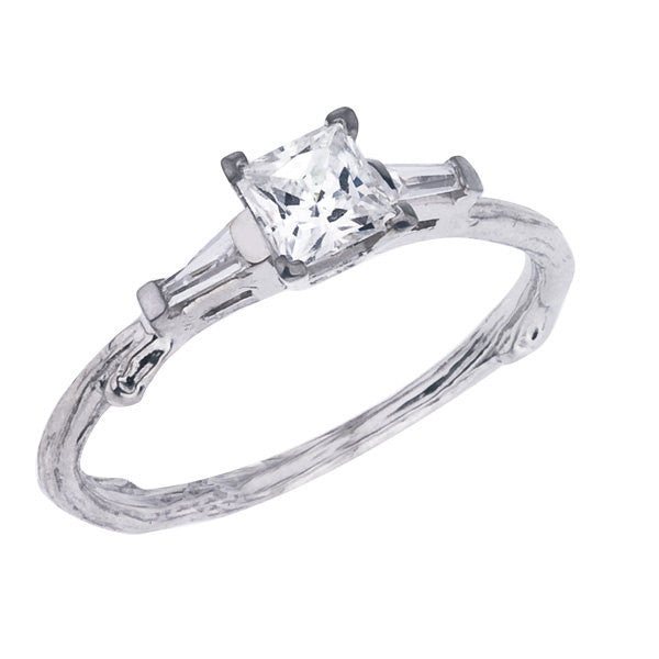 Princess cut diamond twig engagement ring with a tapered baguette on each side.  Center stone is certified by GIA.