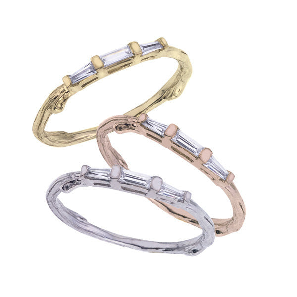 The baguette wedding band with three diamond baguettes across the top.  Shown in yellow, rose and white 18K recycled gold.