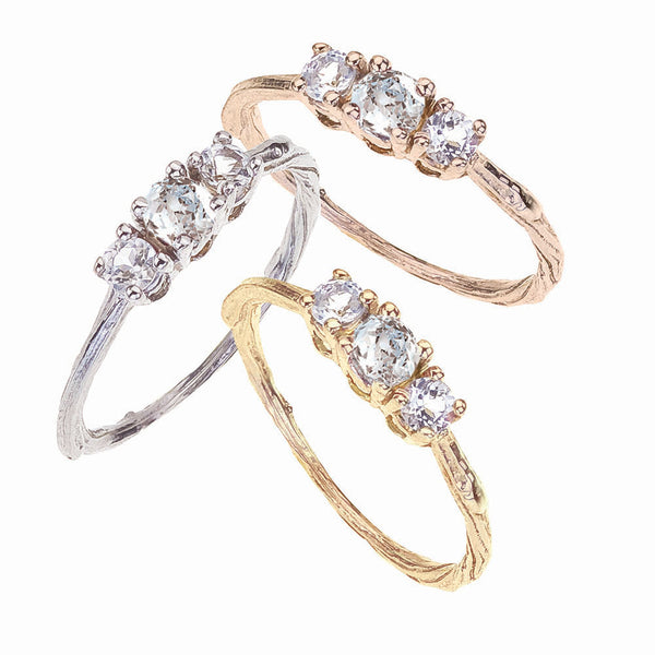 Three round brilliant white diamonds are the focus of these beautiful engagement rings shown in white, rose and yellow 18K eco friendly gold.