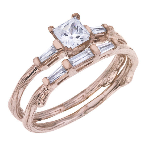 Princess Diamond Wedding Set.  The engagement ring features a GIA certified princess cut diamond flanked by tapered baguettes.  The matching wedding band has baguettes across the top.  All handmade in rose 18K reclaimed gold.