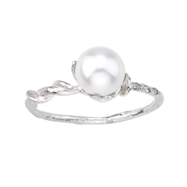 Gracefully asymmetrical.  Pearl, diamond and white gold engagement ring.