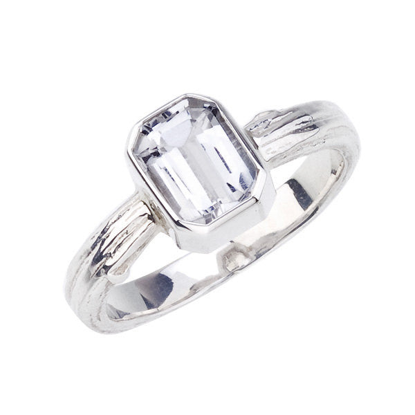 white gold engagement ring with large emerald cut diamond and wide natural band.  recycled 18K white gold