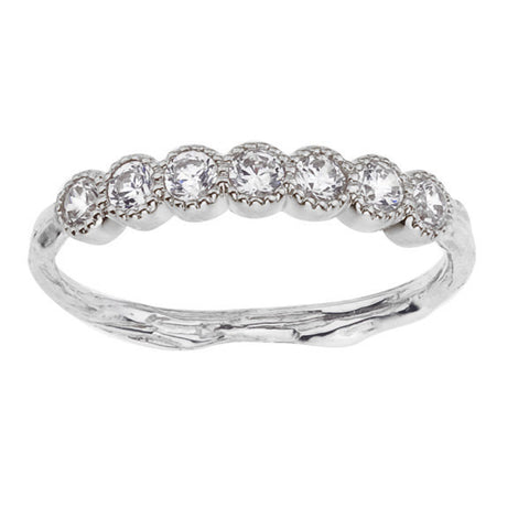 Diamond set half eternity wedding band in recycled 18K gold.