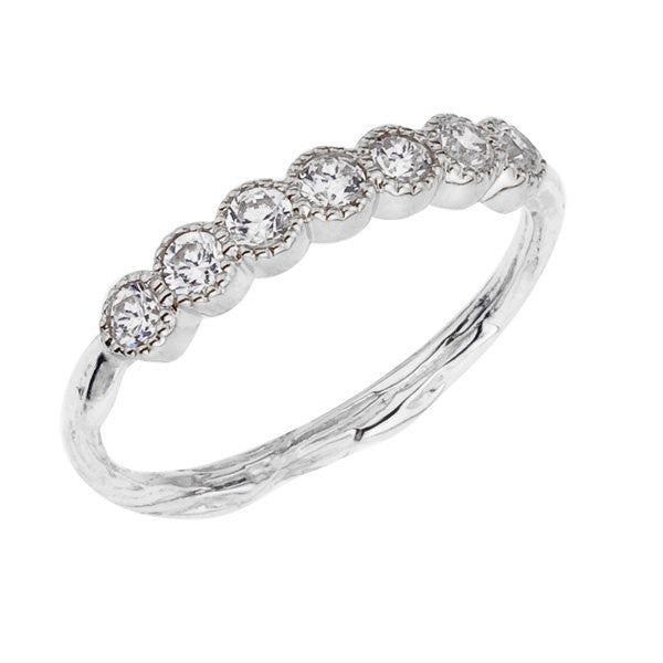Diamond half eternity ring with milgrain detail set on a twig band. Designed by Barbara Polinsky.