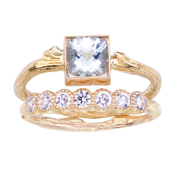 Lucky seven diamond eternity band is shown with a one of a kind engagement ring.