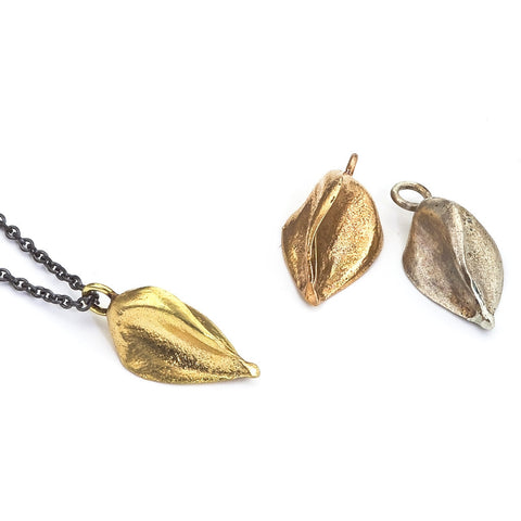 Recycled gold seed pendant necklace on an oxidized sterling silver chain.