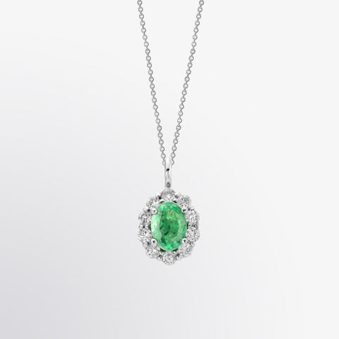 Oval Shaped Emerald and Diamond Halo Pendant