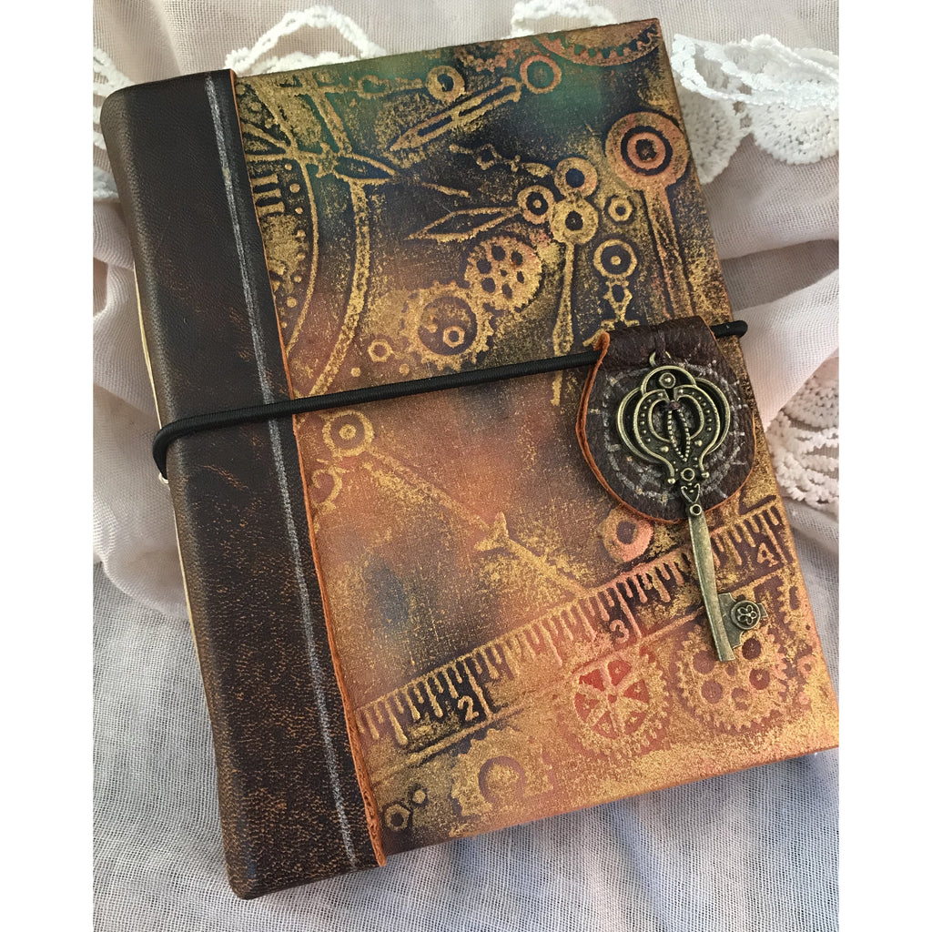 Hand made A6 Art Journal Leather and fabric.