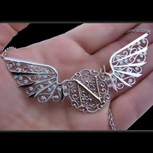 Rarest Element Winged Nd Necklace