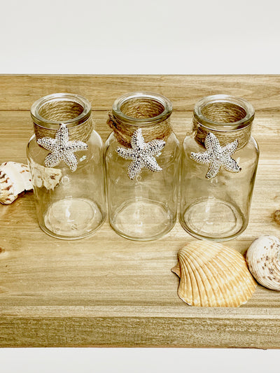 3 glass bottles vases with starfish