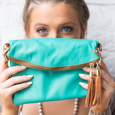 Turquoise and tan leather handbag