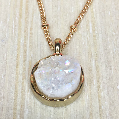 close up of white druzy pendant necklace