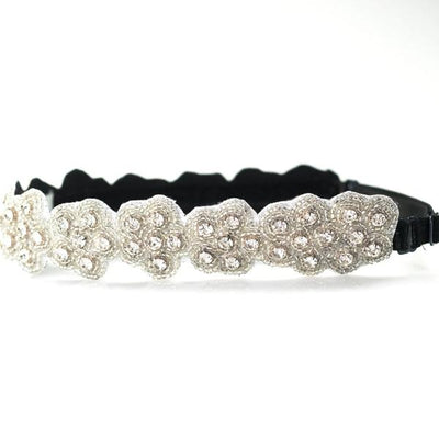 Floral bridal headband made with crystals and an adjustable elastic strap
