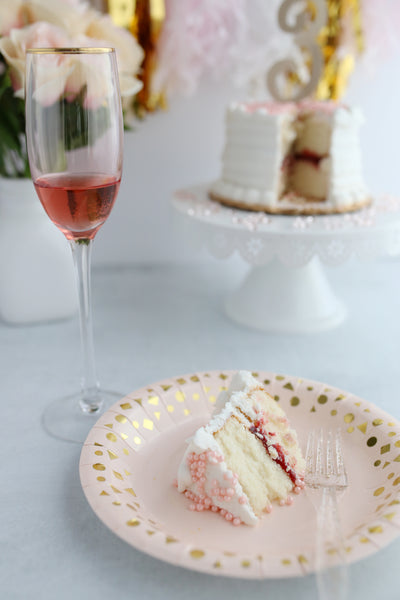 pink Champagne party with cake and wine glass