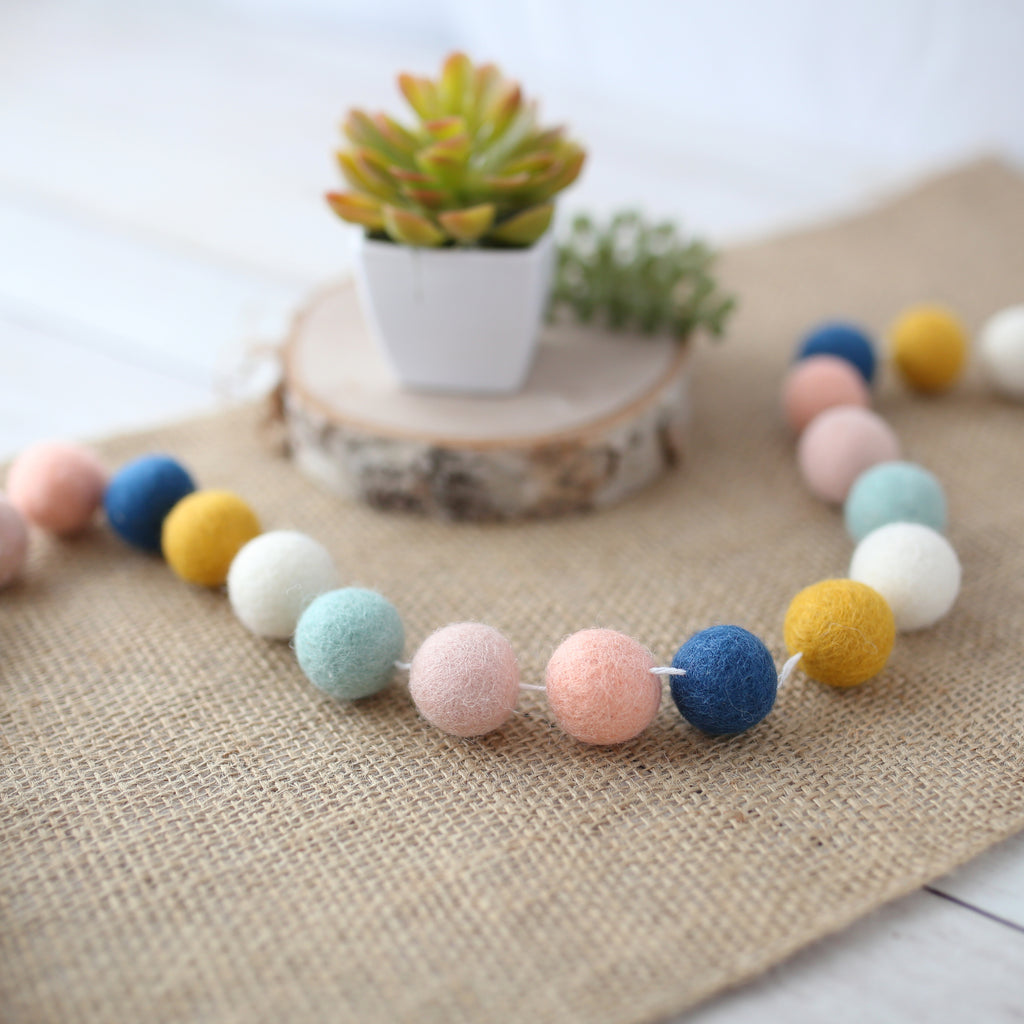 navy peach mint mustard felt ball garland with succulent