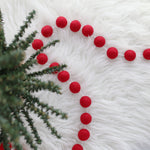 All red felt ball garland with green tree