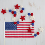 Red white and blue felt ball garland with American flag for the fourth of July