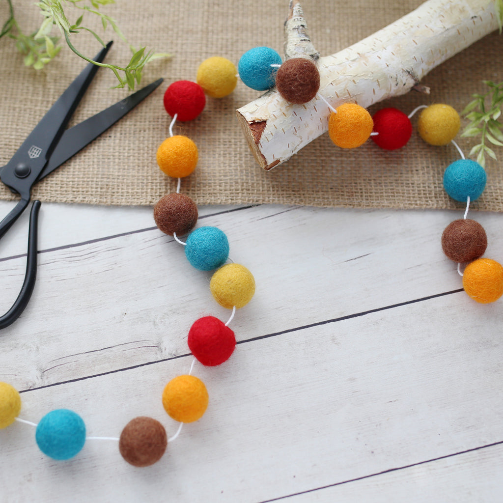 felt ball thanks giving garland in teal, orange, red, brown and mustard