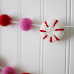 close up of felt peppermint Whoville felt ball garland