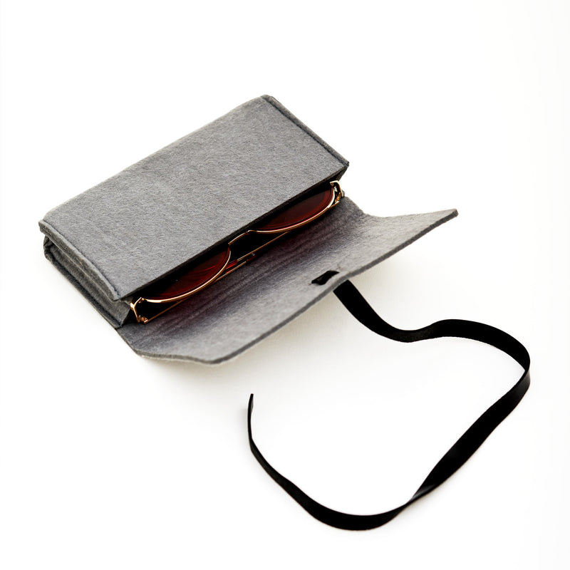 Original SOLFUL Ibiza sunglasses case made from durable hard cotton with black safety strap