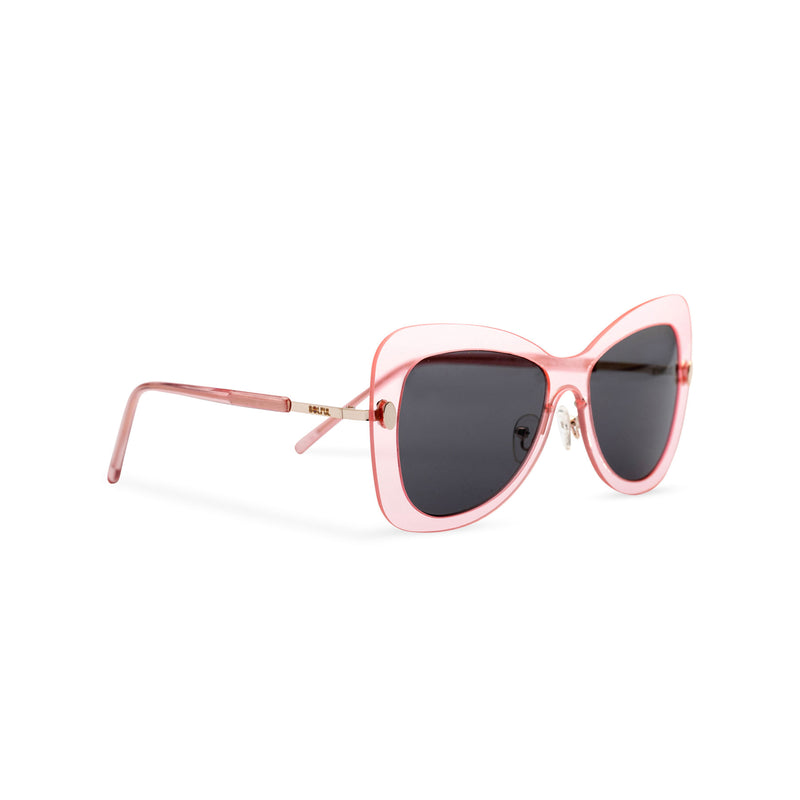Side view butterfly big Ibiza sunglasses with transparent pink frame and black lenses MARIPOSA