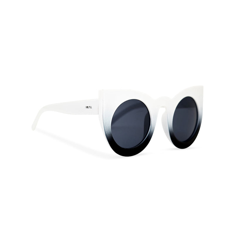 Side of Black and white women cat eye sunglasses from solid plastic and dark lens