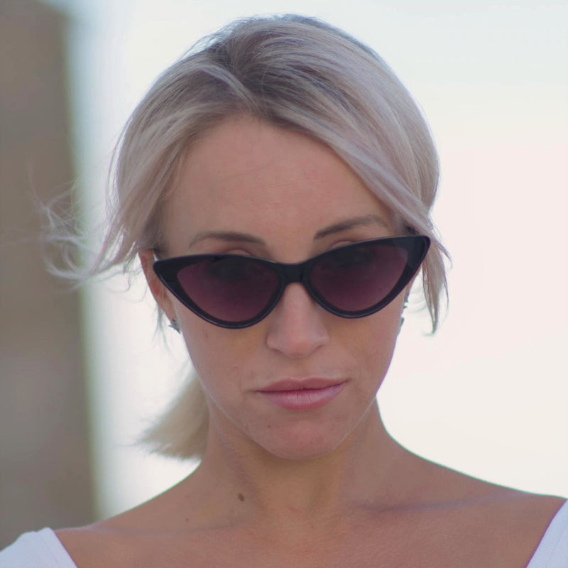 black cat eye sunglasses worn by blond ibiza women