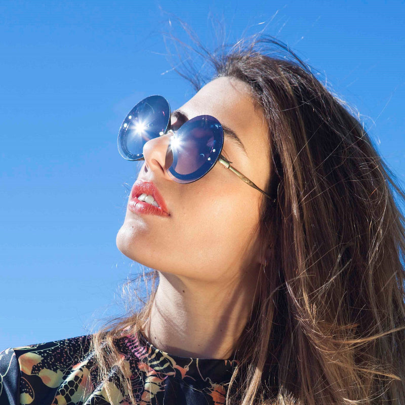 Beautiful Women wear MYSTIQUE Blue round sunglasses by SOLFUL Ibiza