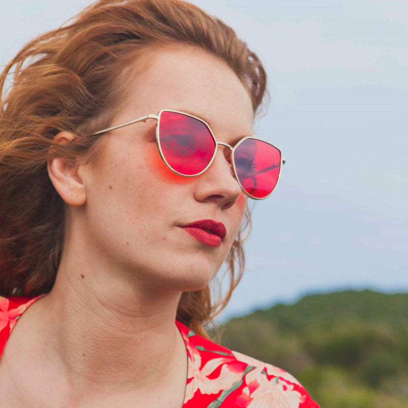 Beautiful redhead liwia in red dress wearing SOLLY metal cat eye sunglasses with red lens
