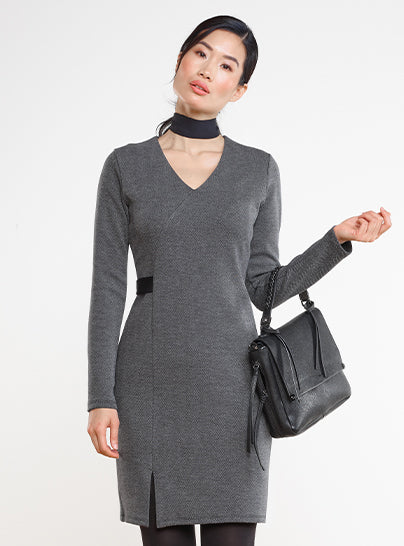 Woman wearing a herringbone jaquard dress