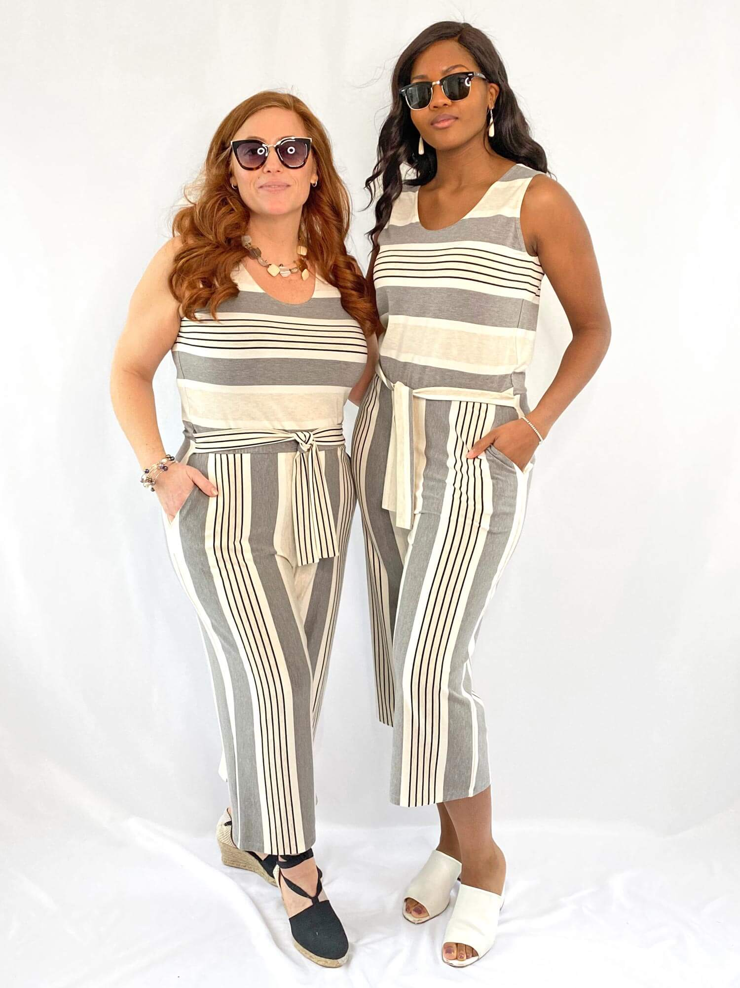 Two models wearing striped jumpsuits