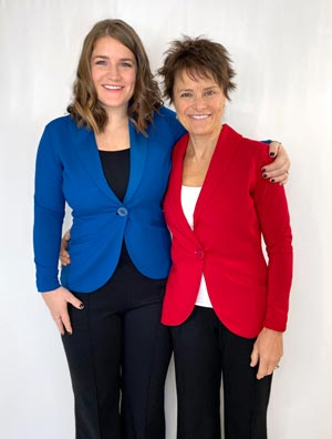 Two women wearing blazers