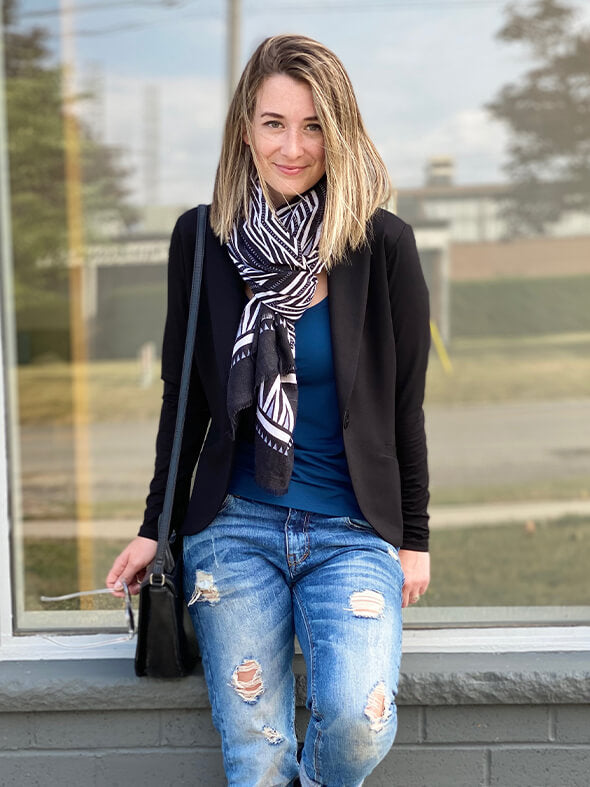 The Emily blazer in black, styled with jeans