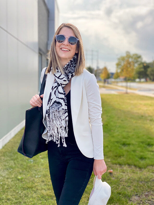 The Emily blazer in natural, worn with dark jeans and a black and white scarf