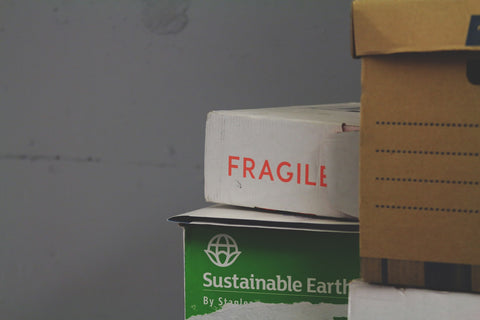 "Cardboard shipping box marked ""fragile"""