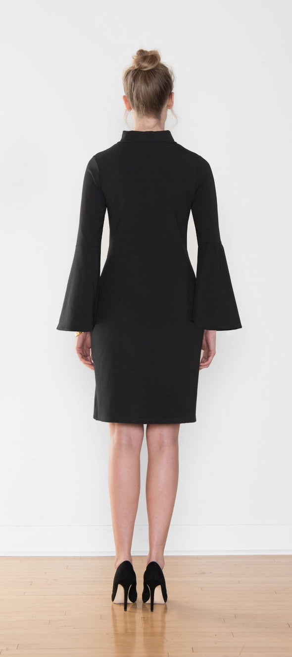 Back view of women's knee-length dress with wide bell sleeves and funnel neckline