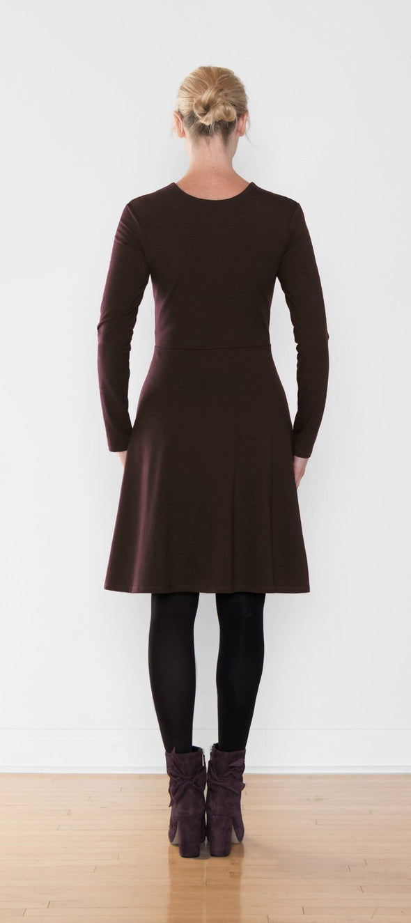 Back view of women's dark brown fit and flare dress with long sleeves