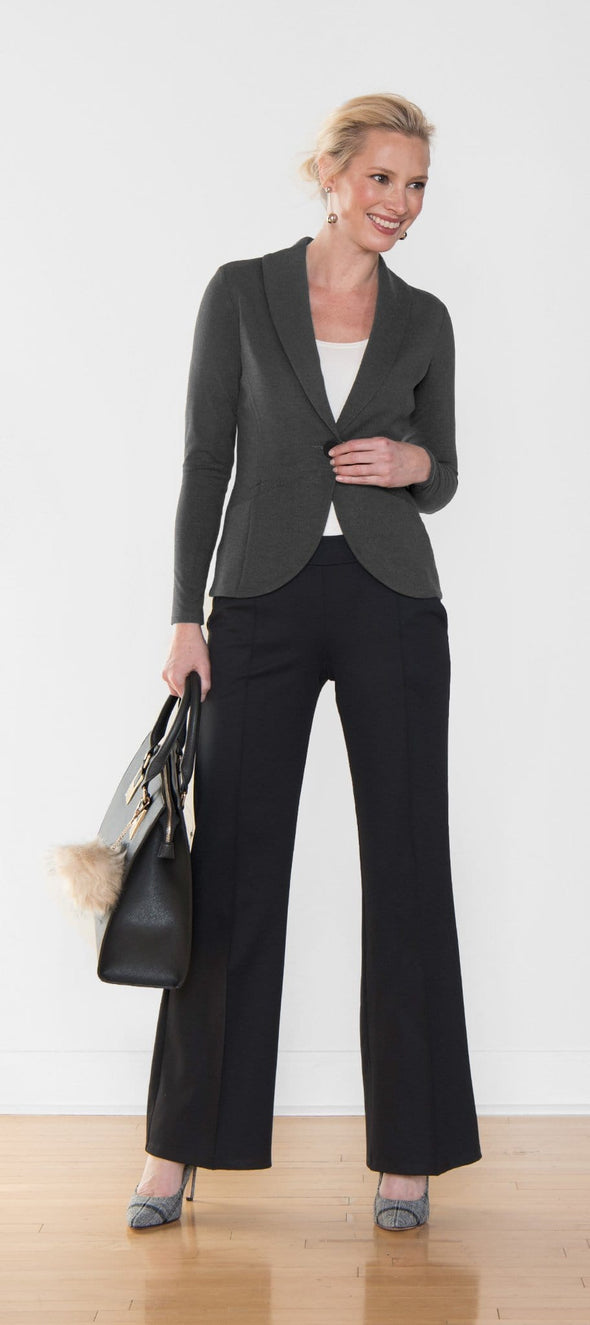 Woman wearing a dark grey blazer and black wide leg pants