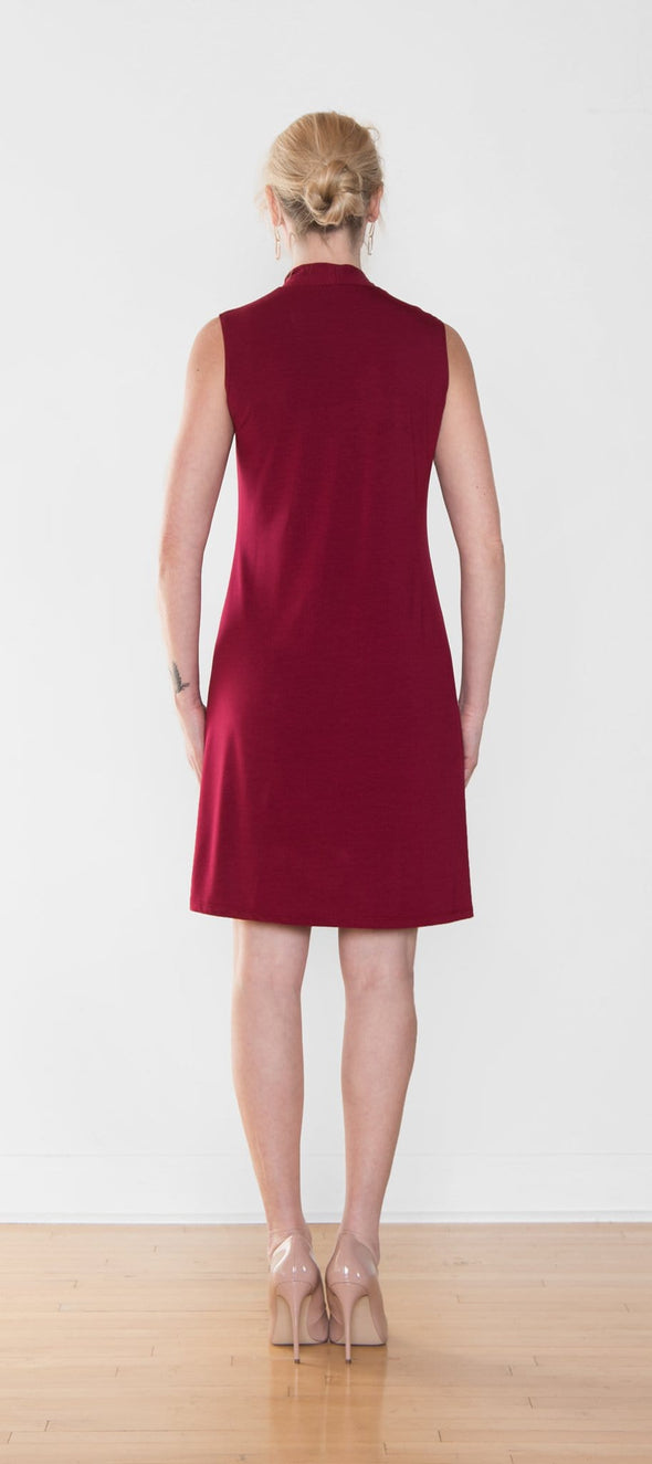 Back view of women's sleeveless A-line dress in red