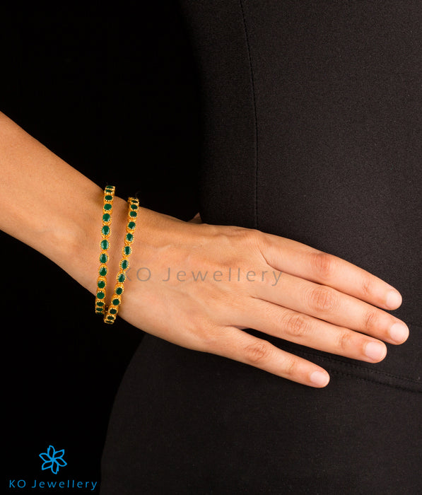 Stunning gold coated bangles with green gemstones