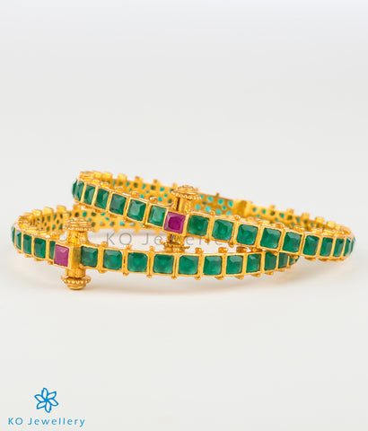 Openable gold coated bracelet with green stones