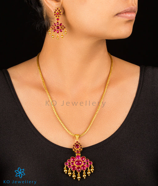 Reversible gold necklace set with red stones