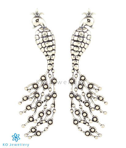 The Tanuruha Silver Peacock Earrings