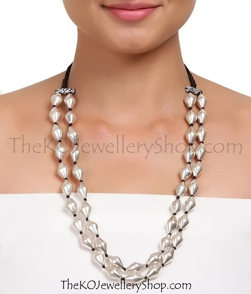 The Silver Dholki Beads Necklace(2 line-long) - KO Jewellery