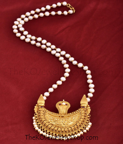 A traditional temple jewellery pendant in a string of pearls