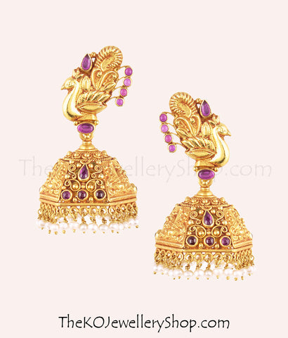 Intricate peacock-motif gold-plated temple jewellery jhumkas