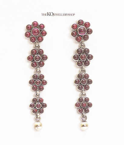 Contemporarily designed temple jewellery earrings with red stones