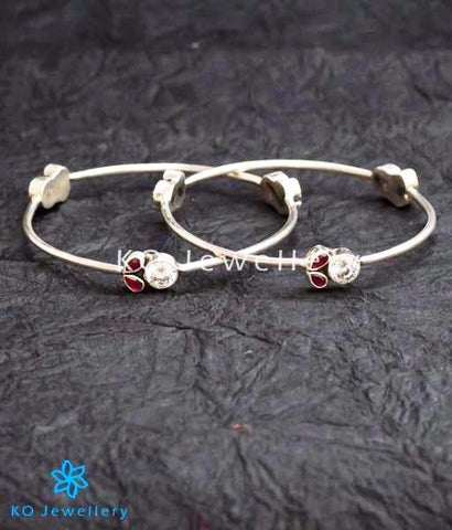 Classic silver bangle studded with semi precious red zircon