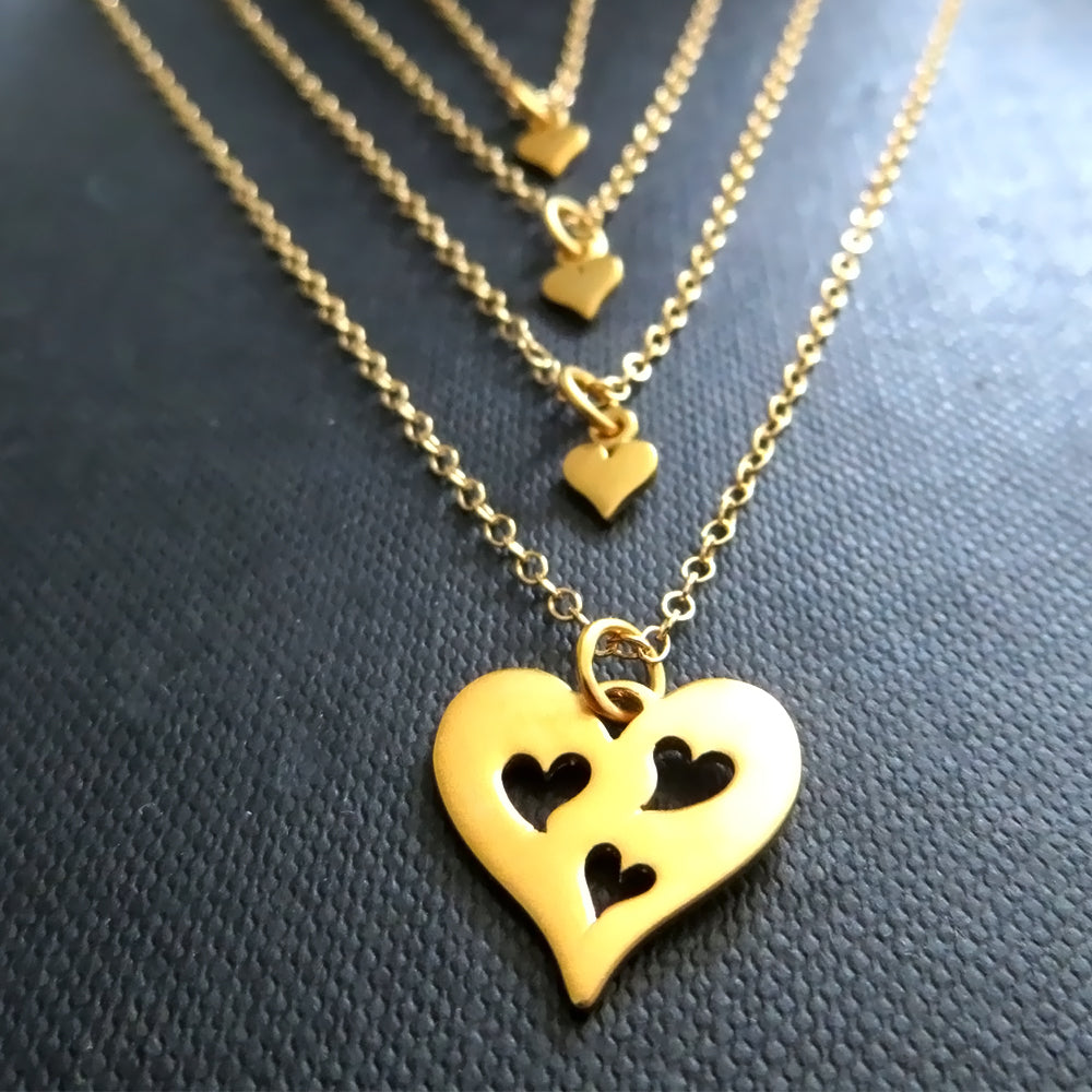 gold Mother 3 daughters necklace, three heart cutout charm - RayK designs